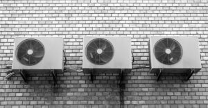 Three air conditioners on the wall.