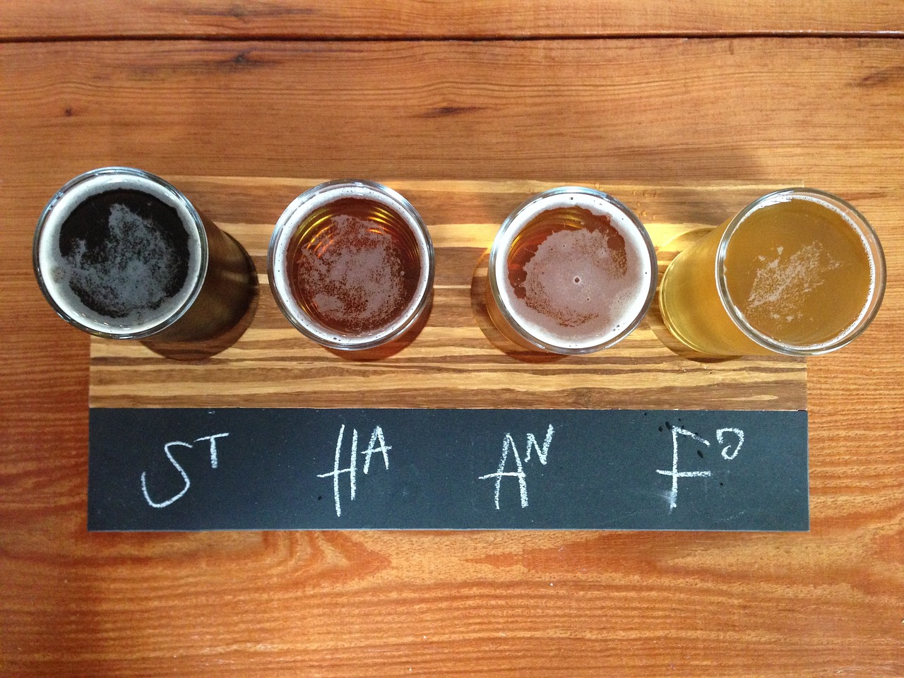 Four glasses of different craft beers