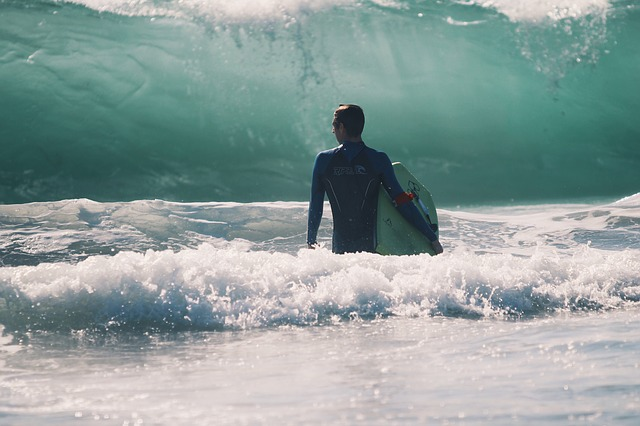 A man surfing in one of the best coastal towns in the USA.