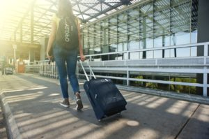 A girl taking her suitcase