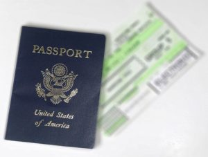 passport and plane ticket for moving to dubai