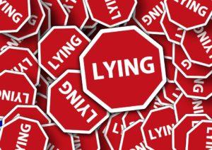 LYING signs