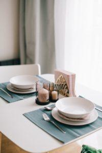 Set plates on table