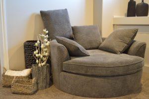 A grey sofa chair