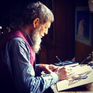 An old man with a beard painting.