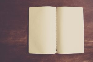 A notebook can be helpful to write down a plan for moving locally in San Diego.