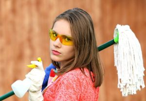 A girls with some cleaning supplies you will also need to clean and pack your basement before moving.