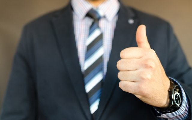 Man holding a thumb up for best rated packing supplies