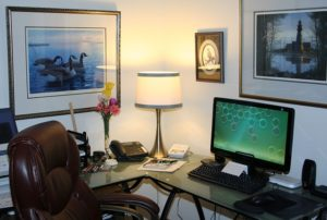Comfortable chair and a desk in a home office.