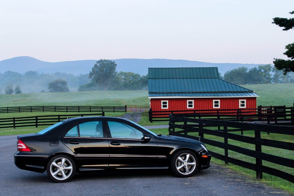 A car parked in front of the ranch. Approach is one of the important things to consider before buying a ranch.