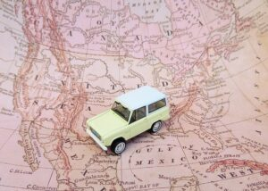 A small model car on the USA map.