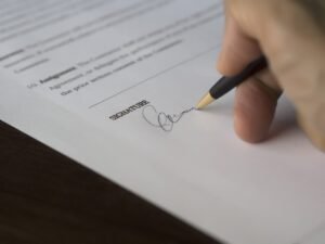 A signature on the contract.