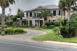 a home in Corpus Christi surrounded by palms