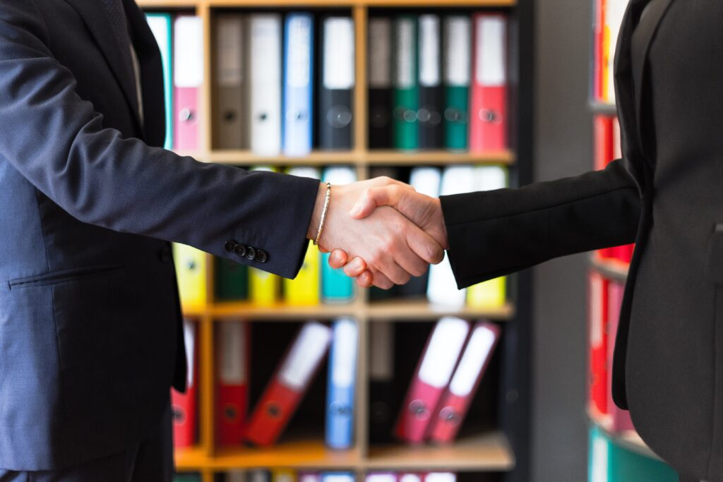 Two men shaking hands after moving your business from LA to San Diego.