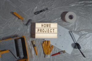 Home project sign surrounded by renovation tools
