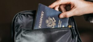 Person putting a passport in a bag before moving from San Diego to Hamilton, Canada.