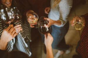 A group of friends sharing a glass of wine.