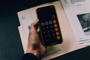 person holding a calculator